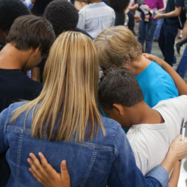People praying in a group
