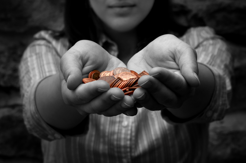 girl holding out coins