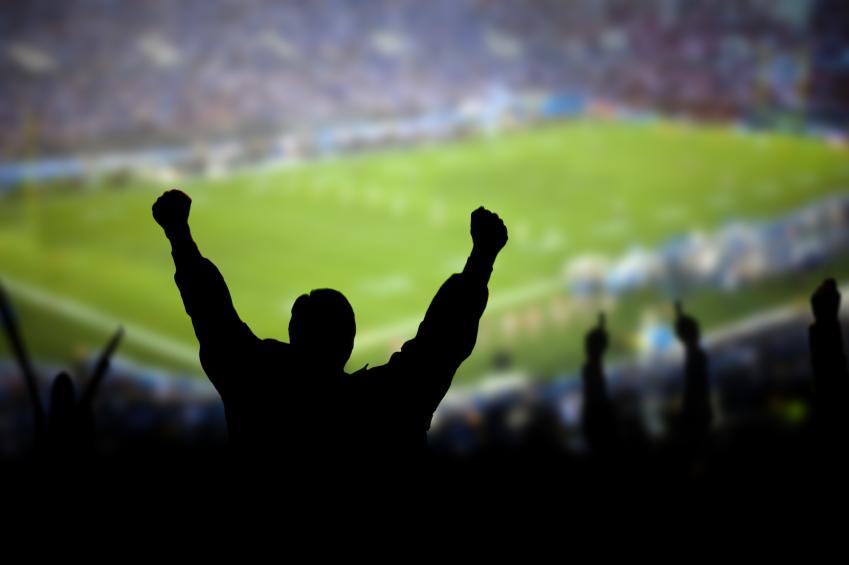 man cheering at game