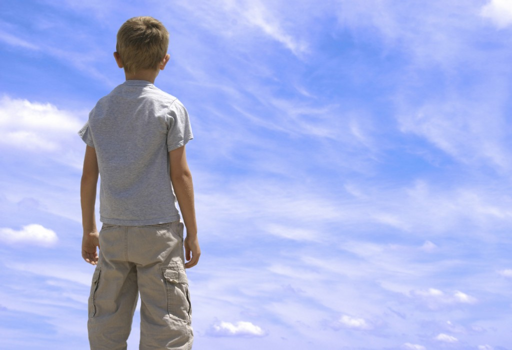 boy looking at blue sky