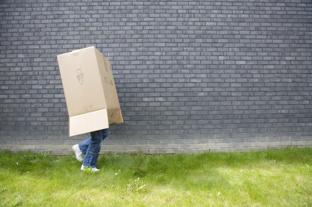 teenager with box on head