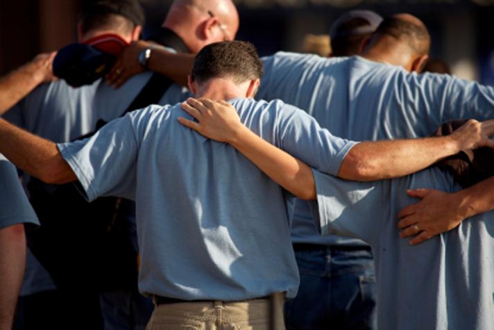 guys huddling and praying