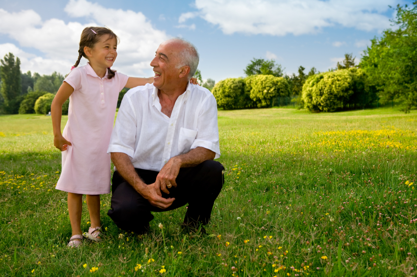 girl and grandfather laughing