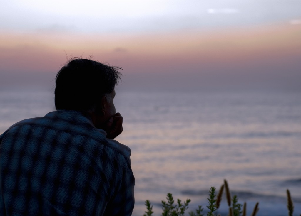 man looking over water