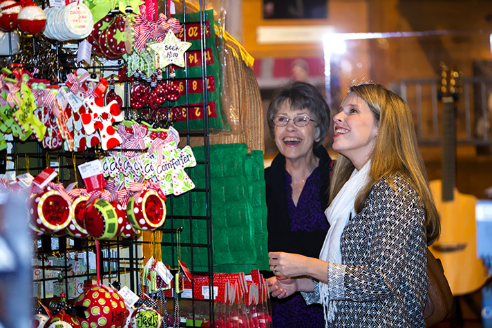 Women browsing ornaments in bookstore