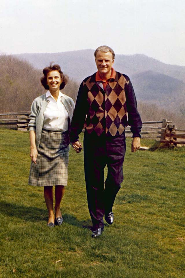 Billy and Ruth holding hands