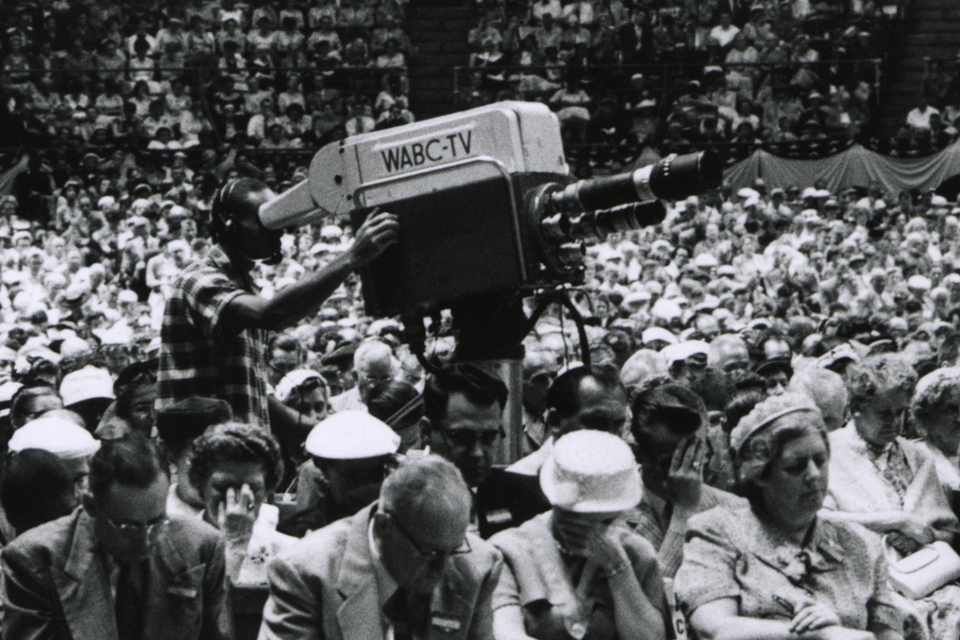 TV camera in crowd