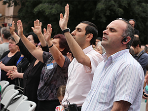 Praising God at the Festival of Hope while listening in Russian.