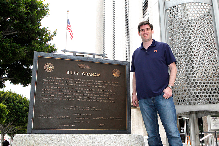 Will Graham stands near the intersection of Washington Boulevard and Hill Street in Los Angeles, site of his grandfather's 1949 Los Angeles Tent Crusades.
