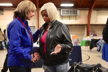 A Rapid Response Team chaplain prays with a Ferguson woman in early December.