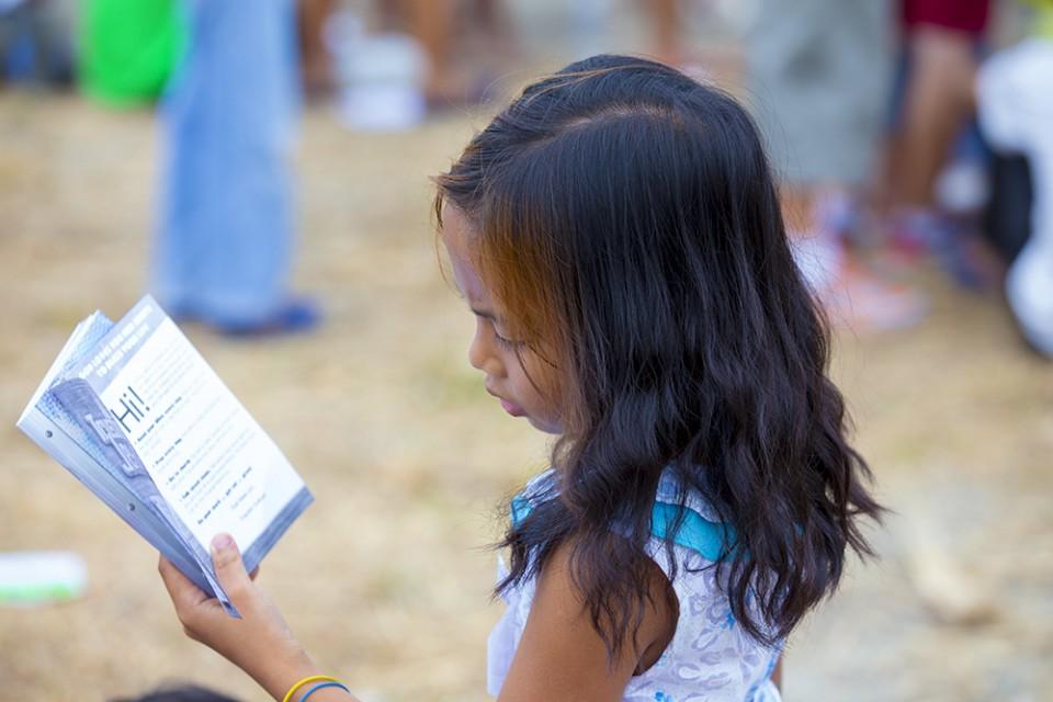 Girl reading pamphlet