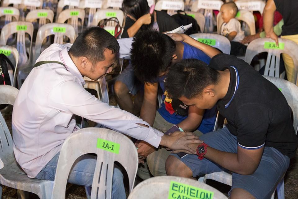 Young men praying
