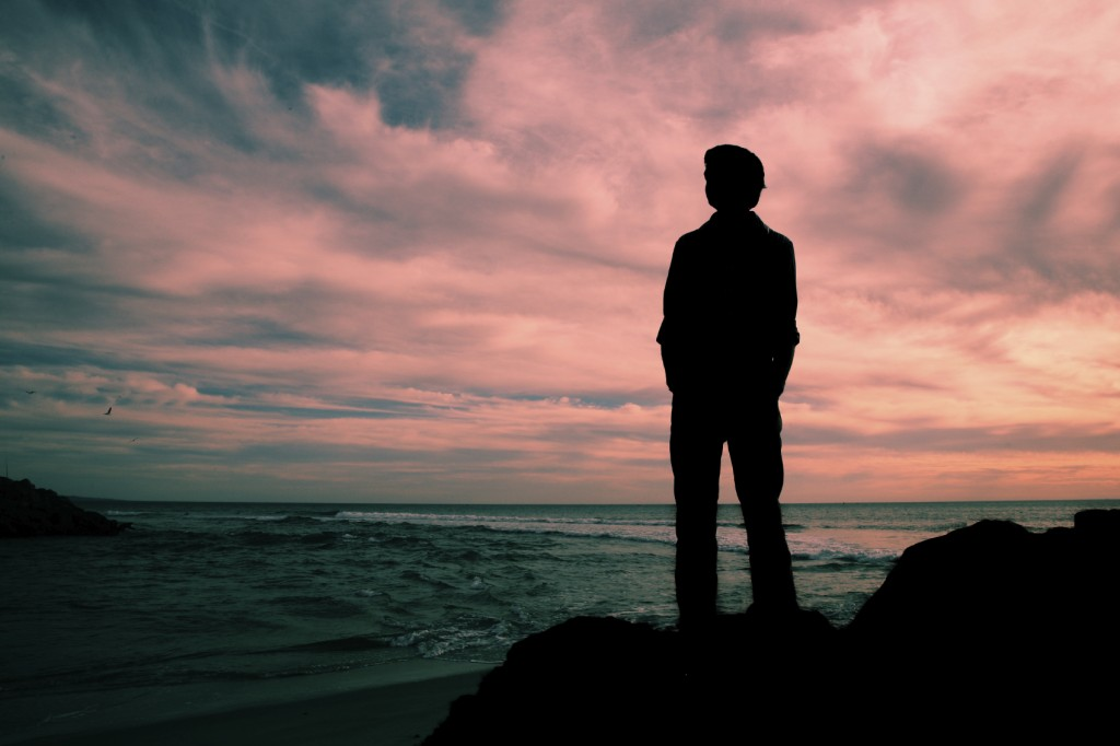 Silhouette of man looking to sky