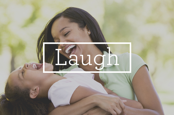 woman daughter laughing