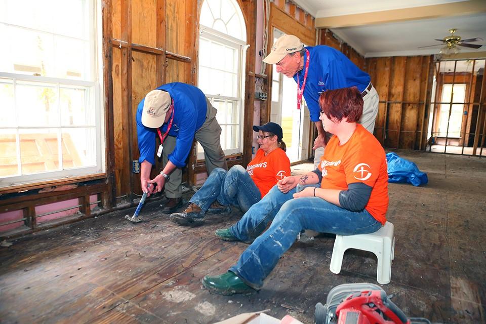Chaplain repairing floor