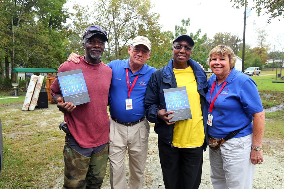 residents hold bibles