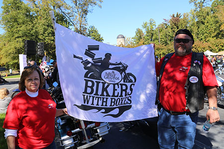 Brenda and John Rumley bought a flag from the Billy Graham Library last year. This year, they displayed it during their ride to the Library from Greensboro, North Carolina.