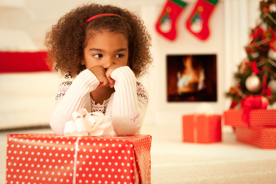 little girl looking sad at Christmastime