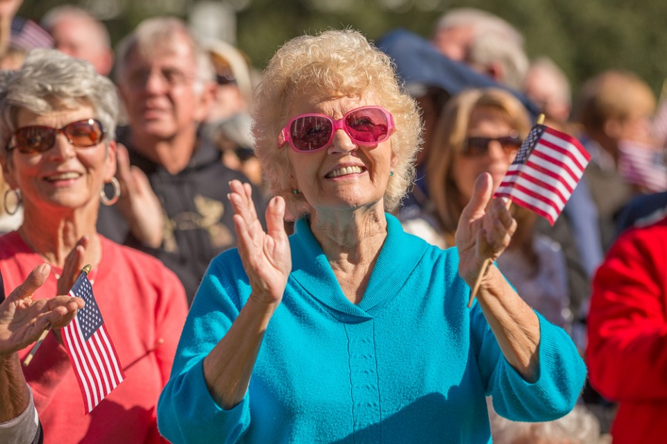 Woman in sunglasses clapping