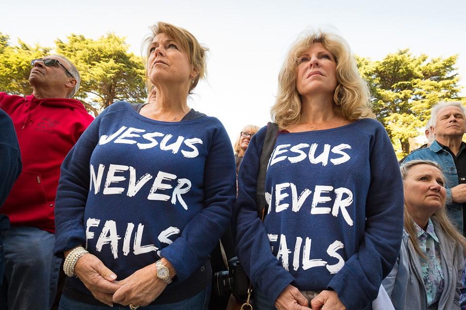 Women wearing 'Jesus Never Fails' shrits.