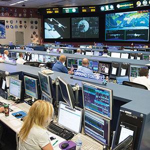 """DATE: 8-12-14 LOCATION: Bldg. 30 - FCR-1 (30M/231) SUBJECT: ISS Flight Controllers during docking of the """"Georges Lemaitre"""" Automated Transfer Vehicle-5 to the aft port of the Zvezda Service Module. PHOTOGRAPHER: Lauren Harnett"""