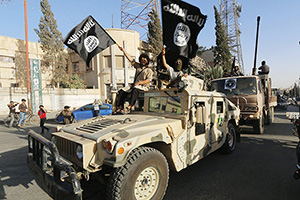 June 30, 2014 - Raqqua, Syria - Islamic State of Iraq and the Levant propaganda photo showing masked militants parading in a captured Humvee June 30, 2014 in Northern Syria. (Credit Image: © Raqqu Media Canter/Planet Pix via ZUMA Wire) (Newscom TagID: zumaamericasthirteen924384.jpg) [Photo via Newscom]