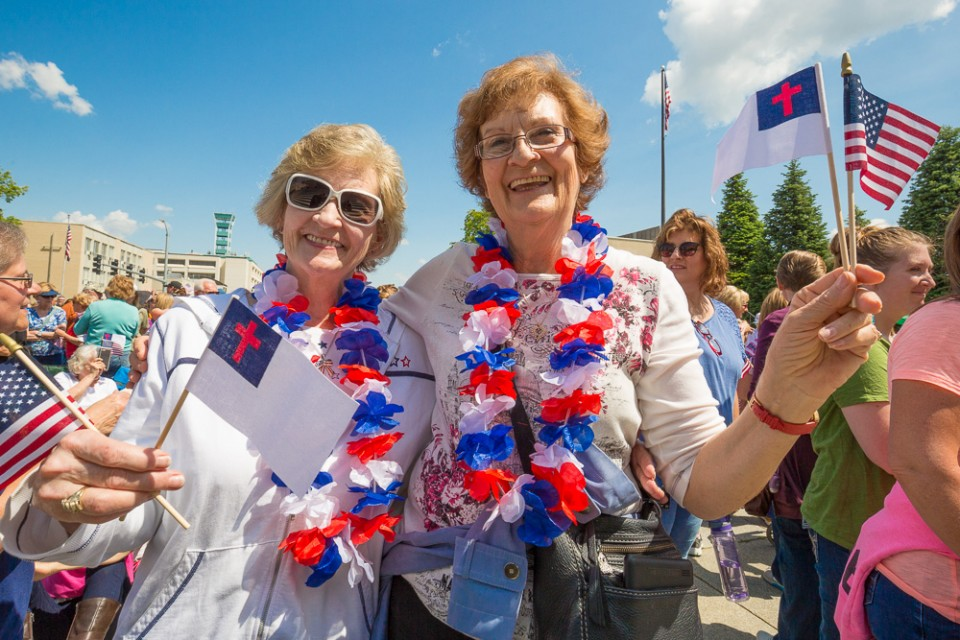 Women smiling with flags