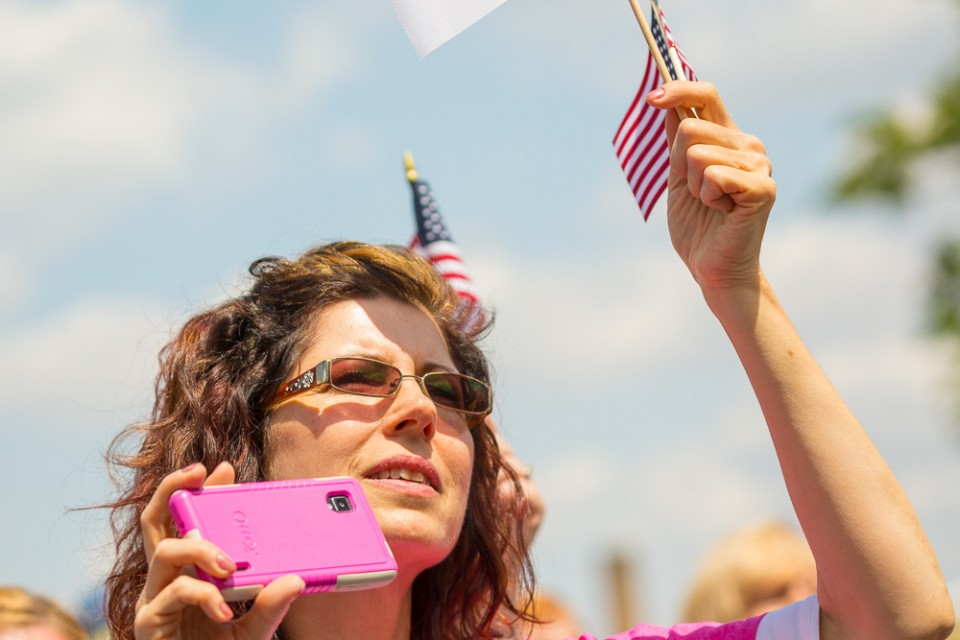Woman with phone and flag
