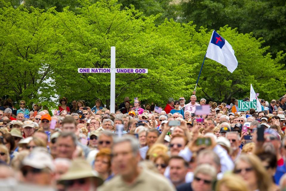 Cross in crowd