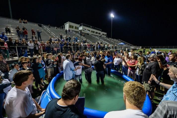 baptism at high school stadium