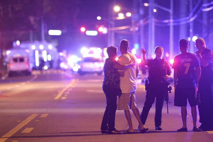 Orlando police officers direct family members away from a fatal shooting at Pulse Orlando nightclub in Orlando, Florida, on Sunday, June 12.