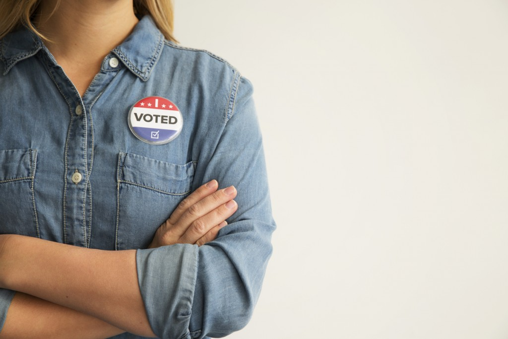 Woman with voting pin