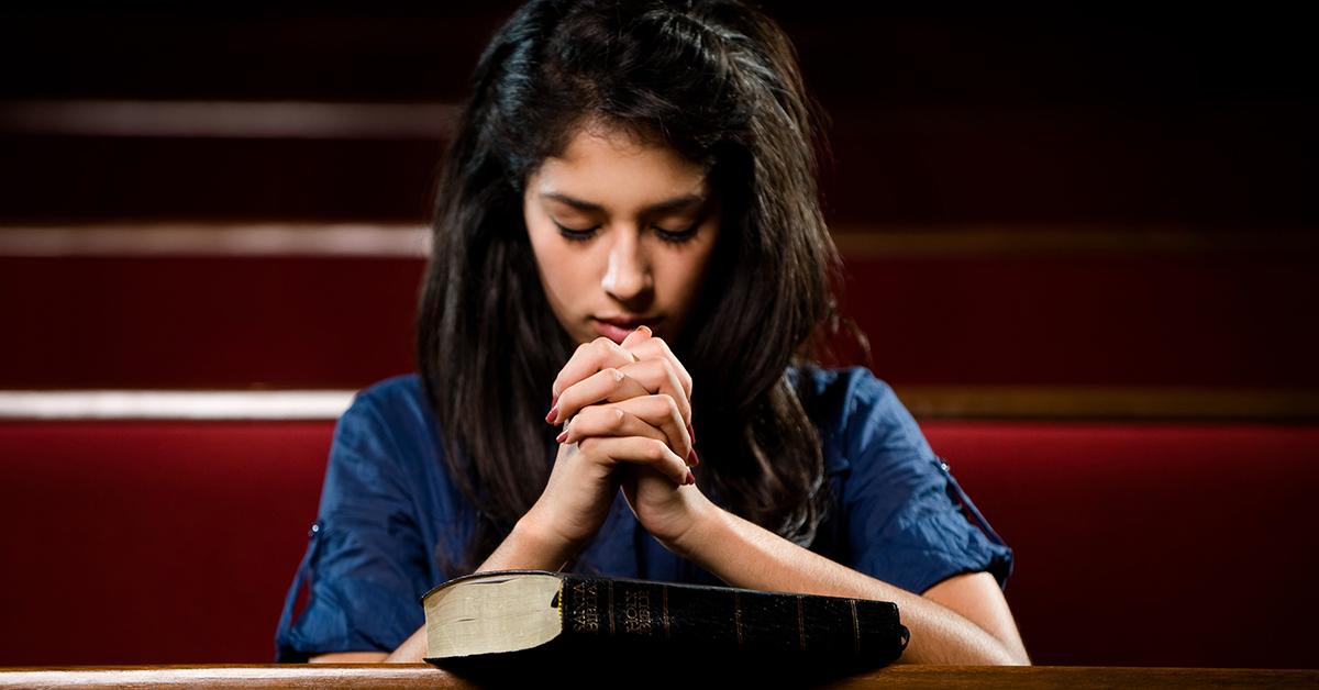 Latin woman praying