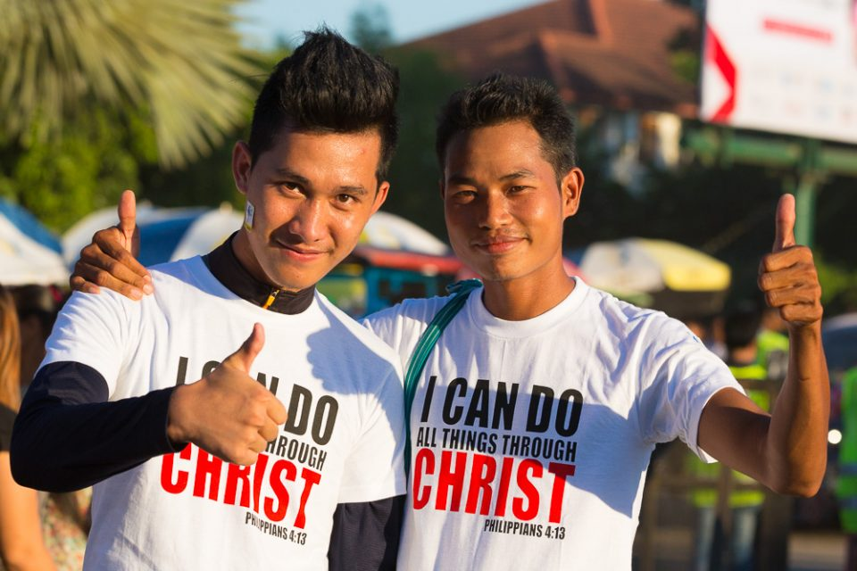 Young men in Christian shirts