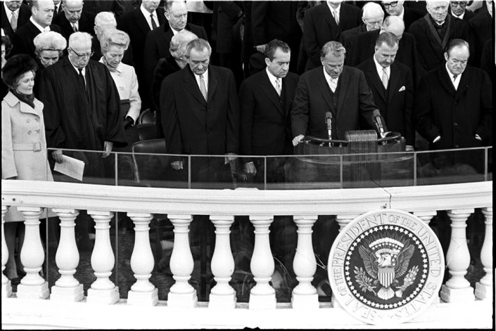 Billy Graham prays during the first inauguration of Richard Nixon in 1969.