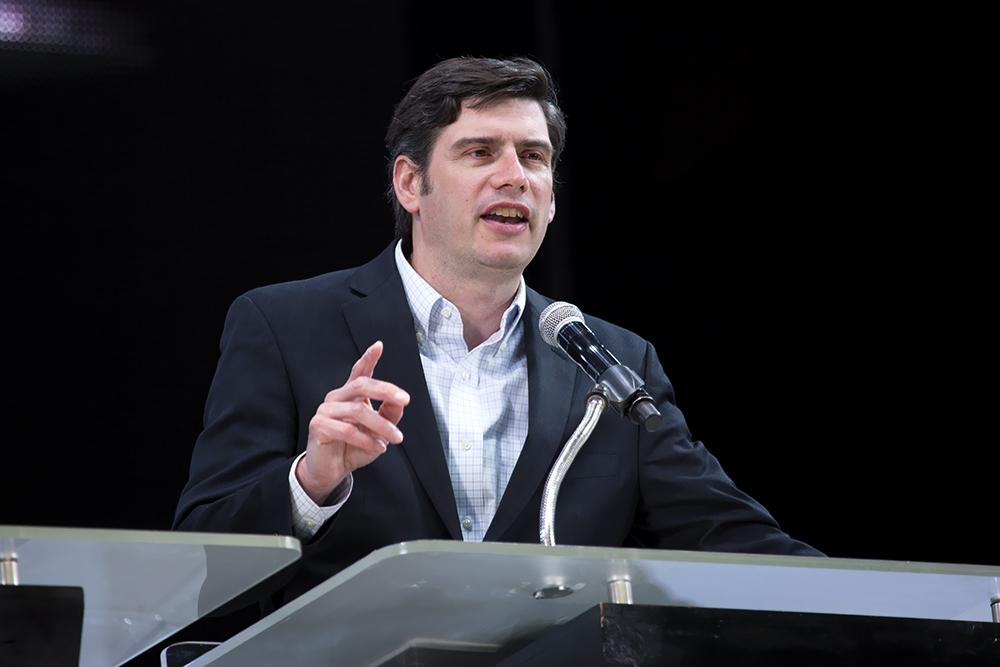 Will Graham preaching at podium