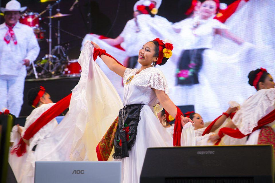 Women dancing in festive dresses