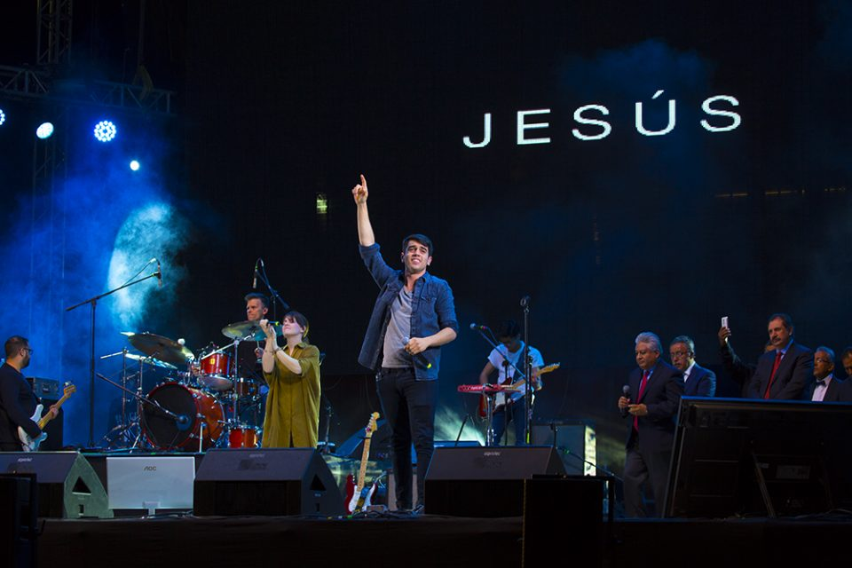 """In Spirit & In Truth"" band on stage with the words ""Jesus"" on large screen"