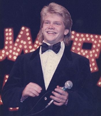Steven Curtis Chapman in a suit and mullet