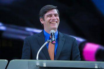 Will Graham smiling at podium