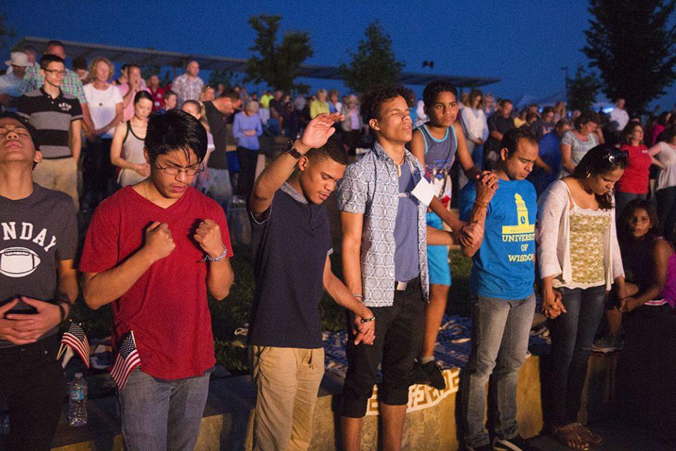 Teen boys holding hands in prayer