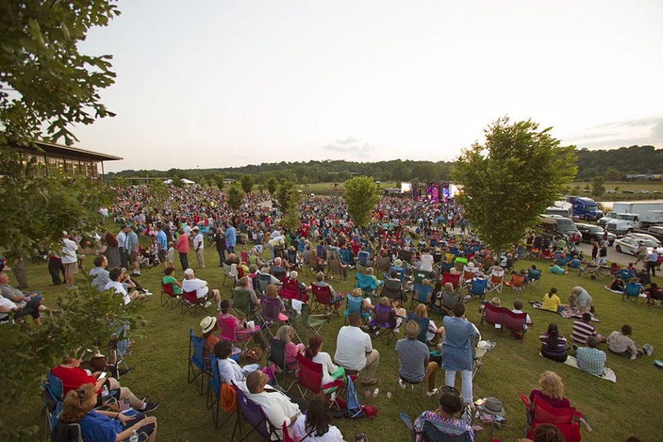 Crowd sitting on lawn