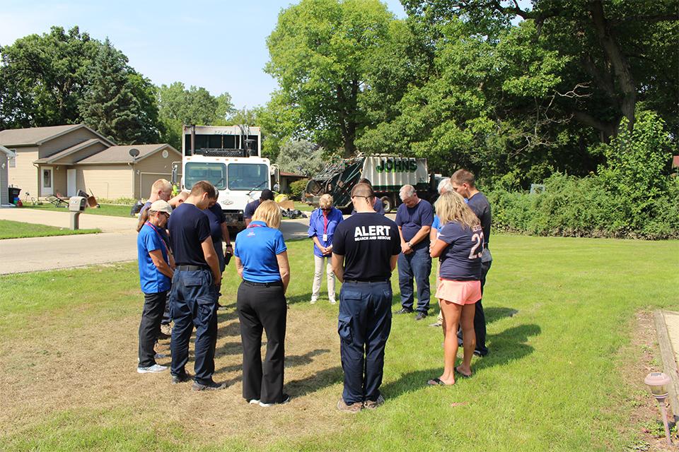 Billy Graham Rapid Response Team Chaplains pray with community members