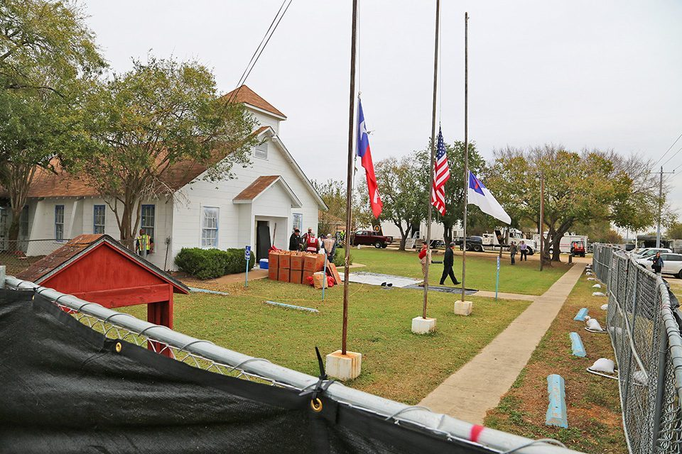 Sutherland Spring's First Baptist Church with flags raised at half staff