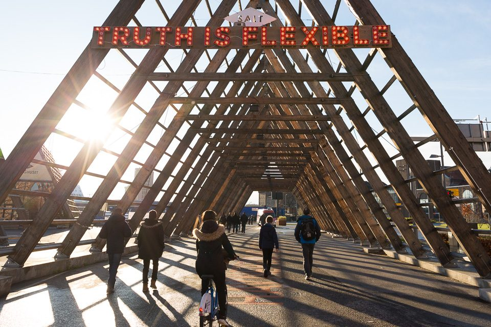 """bridge with sign that says, """"Truth is Flexible."""""""