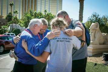 Chaplains praying with man and woman