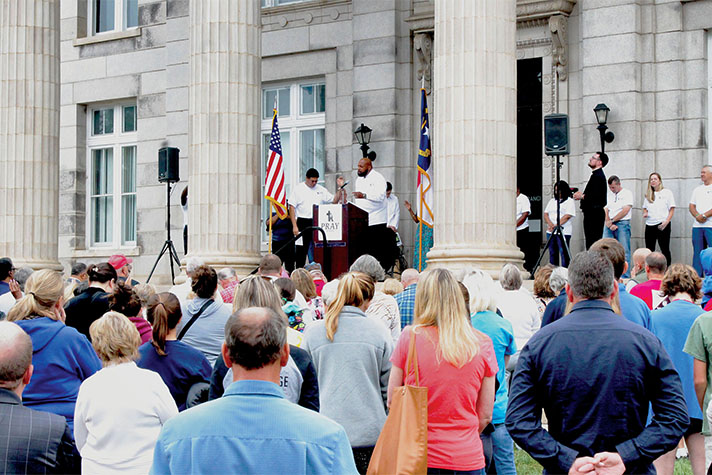 People praying on the steps of Rowan County, NC, courthouse