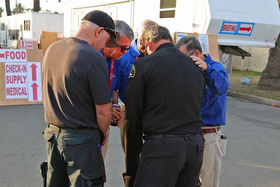 A circle of men praying