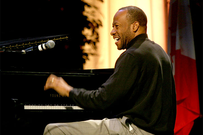 Huntley Brown smiling and playing piano