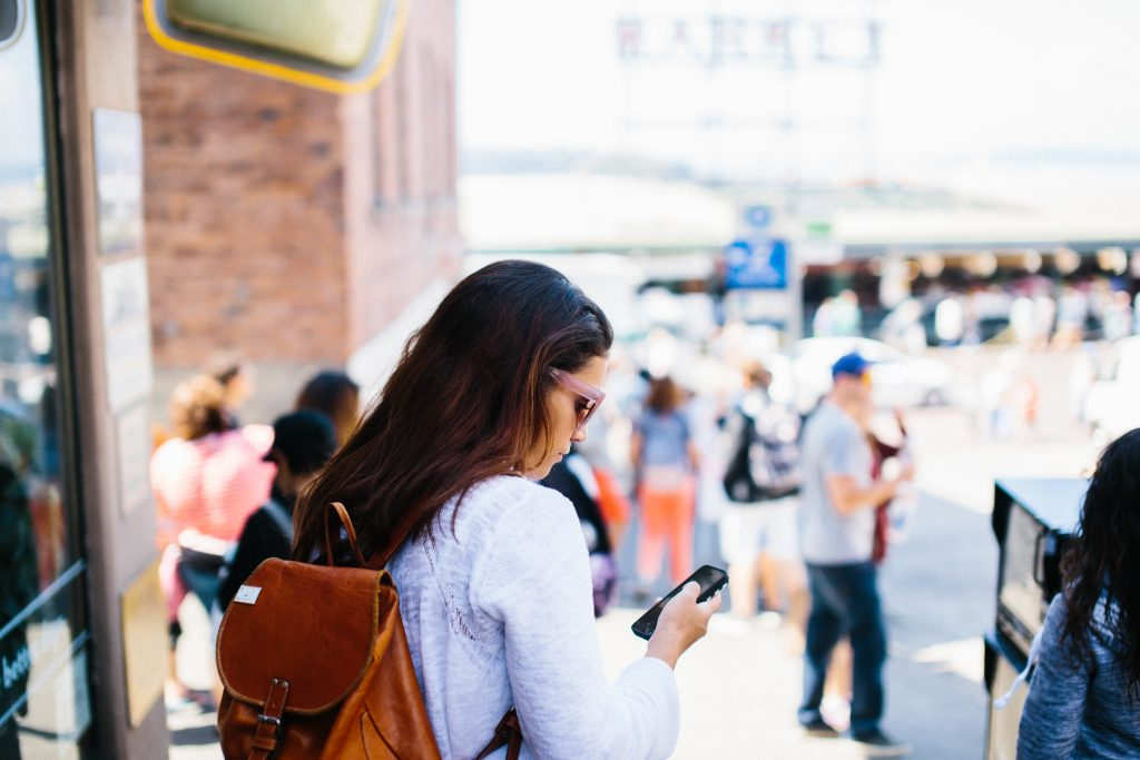 woman on cell phone on crowded street